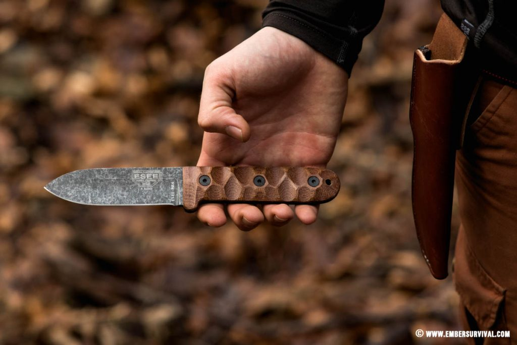 The Esee PR4 is shown here being held in the hand to purposefully show off its textured handle scales