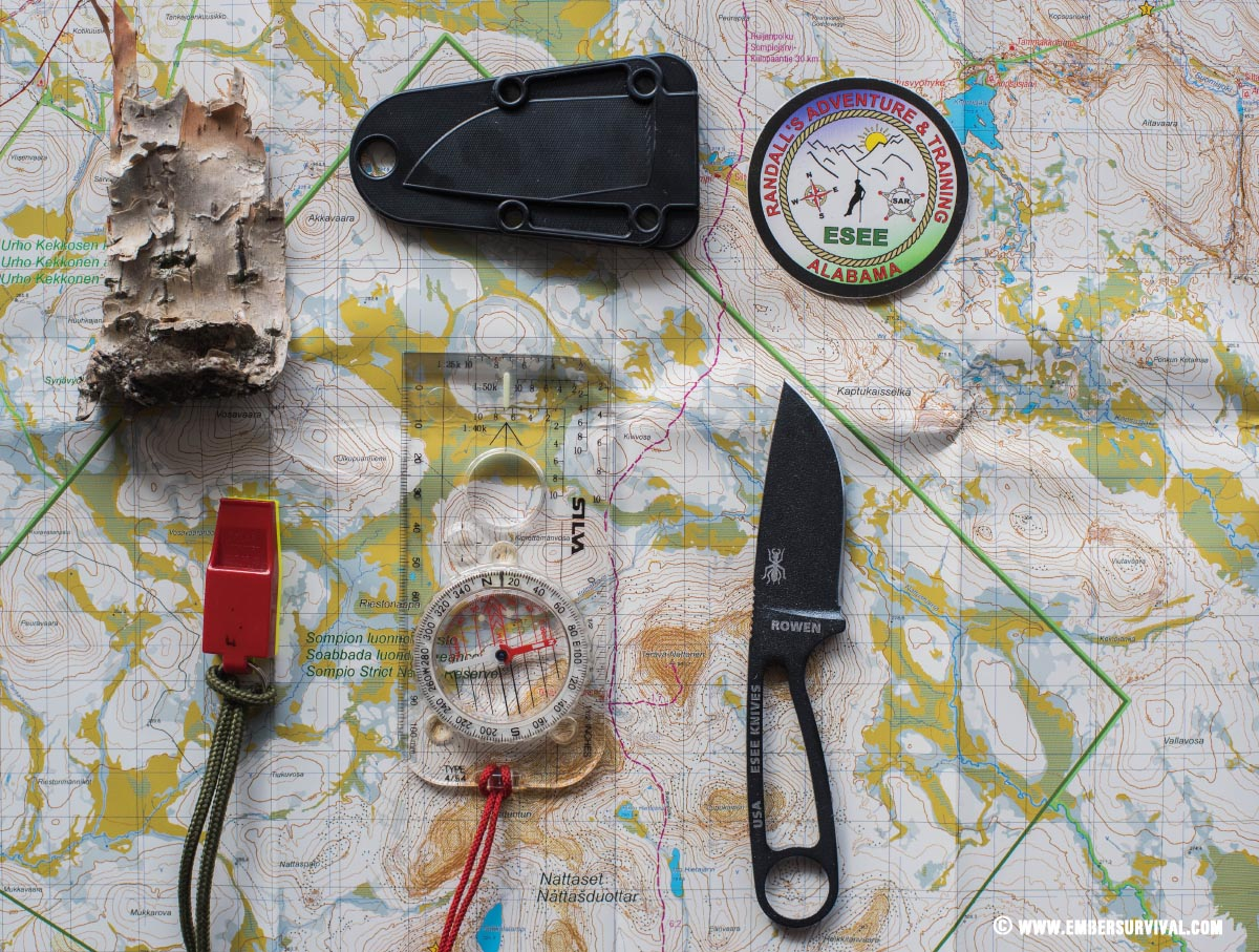 various outdoor tools laid out ontop of a map of Finland
