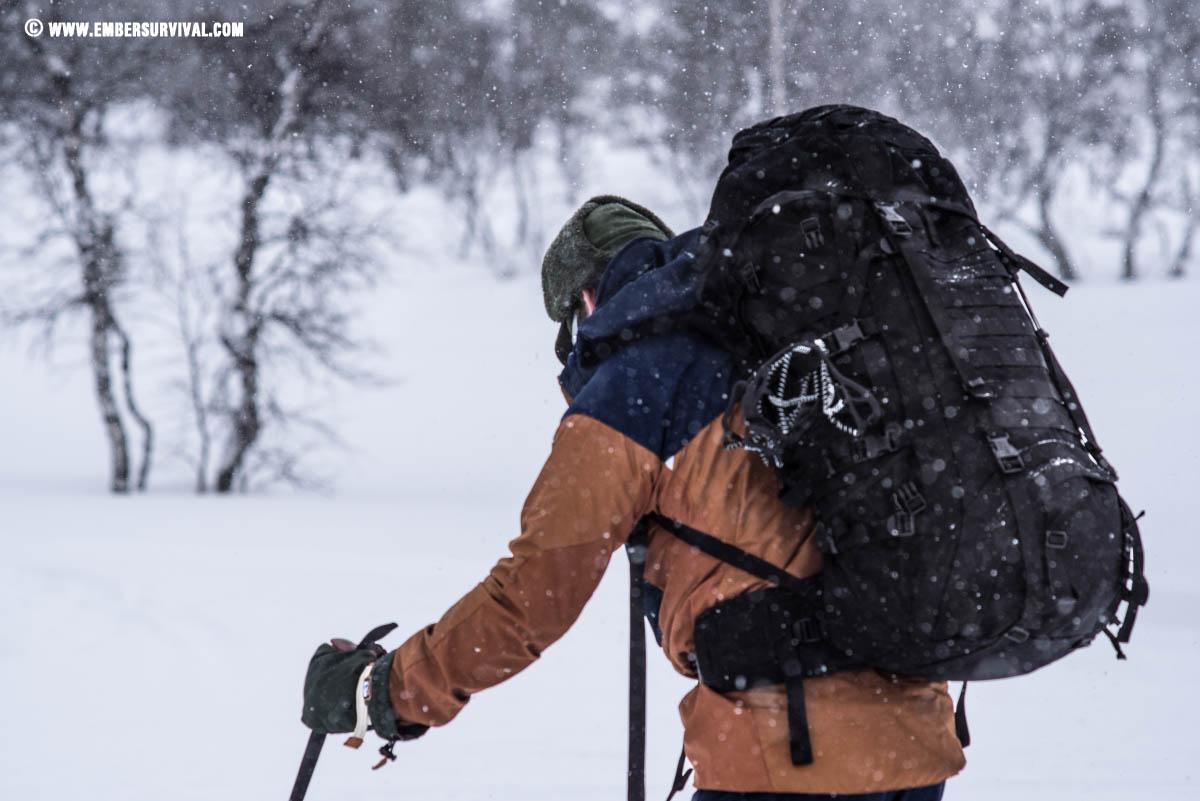 woodsman walking through snow wearing a karrimorsf