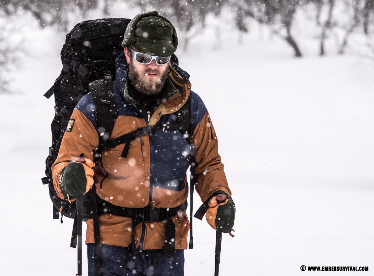 Woodsman snowshoeing through Finnish Lapland.